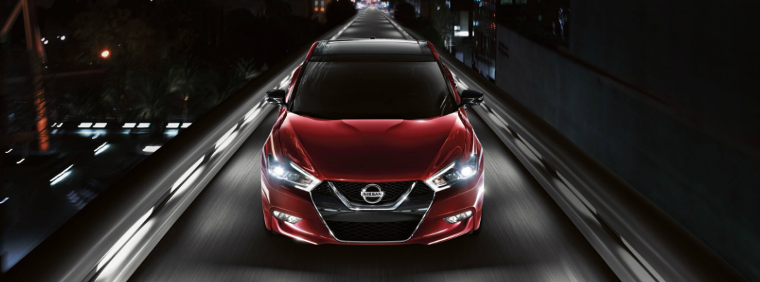 red 2018 Nissan Maxima driving on bridge at night exterior front view