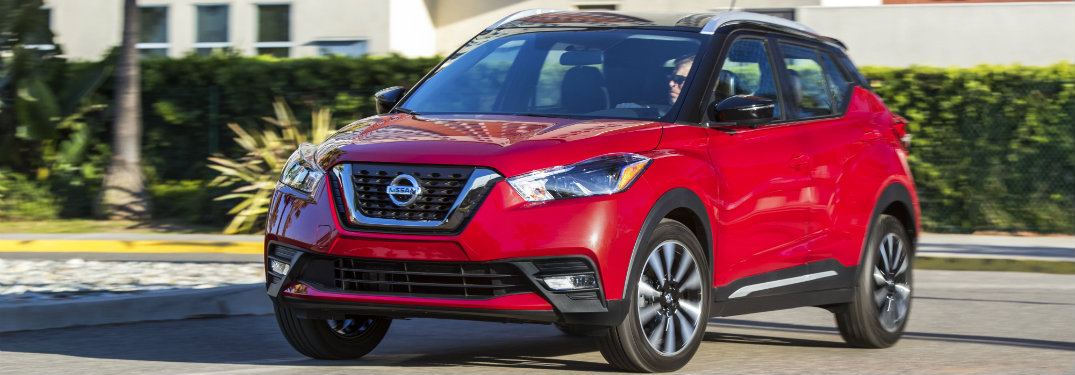 red 2018 Nissan Kicks driving, seen from the side