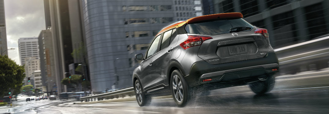 rear view of the 2018-2019 Nissan Kicks driving in the city