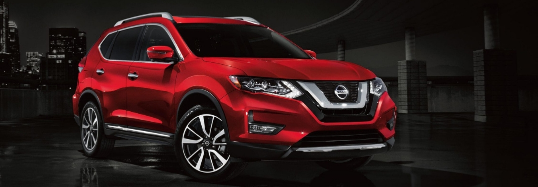 Red 2019 Nissan Rogue on a Black background.