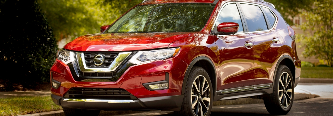 Red 2019 Nissan Rogue on a Country Road