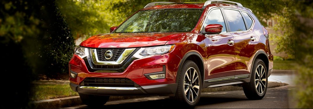 A lovely, red, tow-capable 2019 Nissan Rogue.