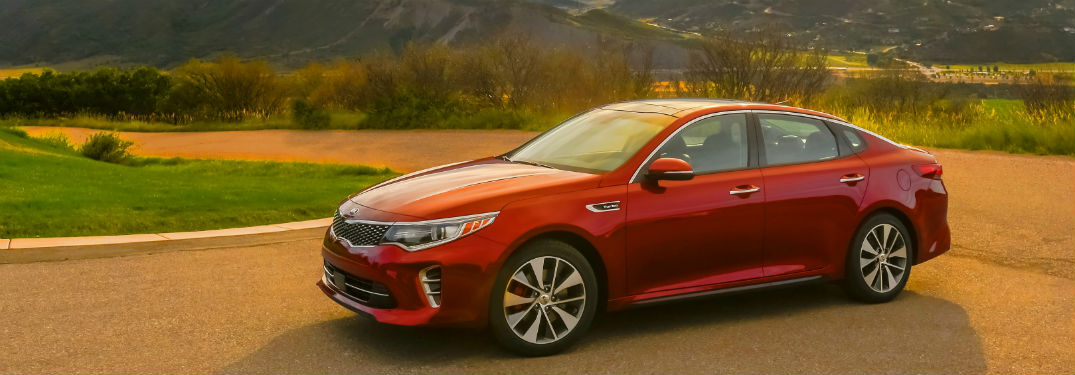 2018 kia optima pictured on scenic hill country drive from front 3/4 view near dayton oh