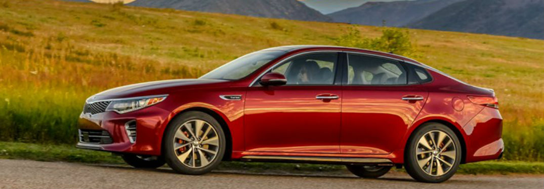2018 Kia Optima Exterior Drivers side with grass and mountain background