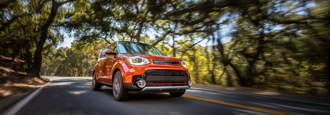 2018 Kia Soul Exterior Front Fascia Passenger side on Road with blurred trees