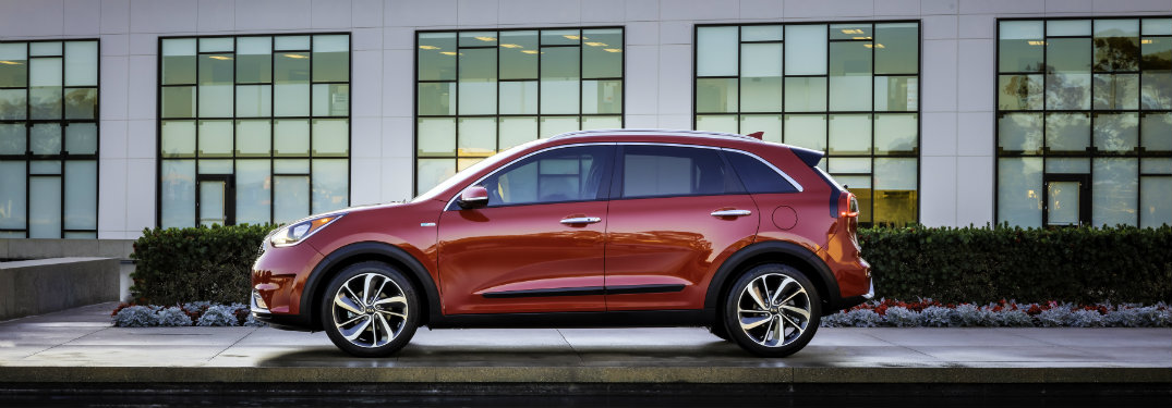 left side view of red kia niro