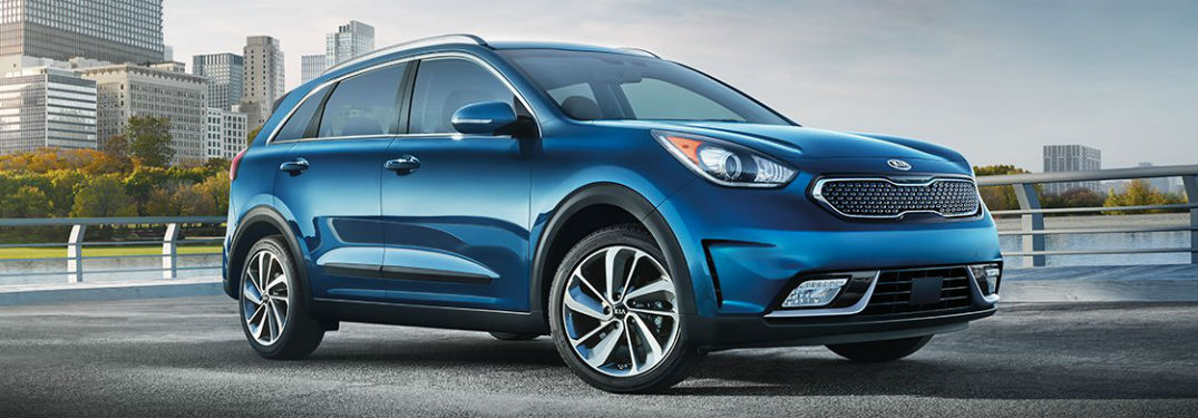 Passenger side exterior view of a blue 2019 Kia Niro