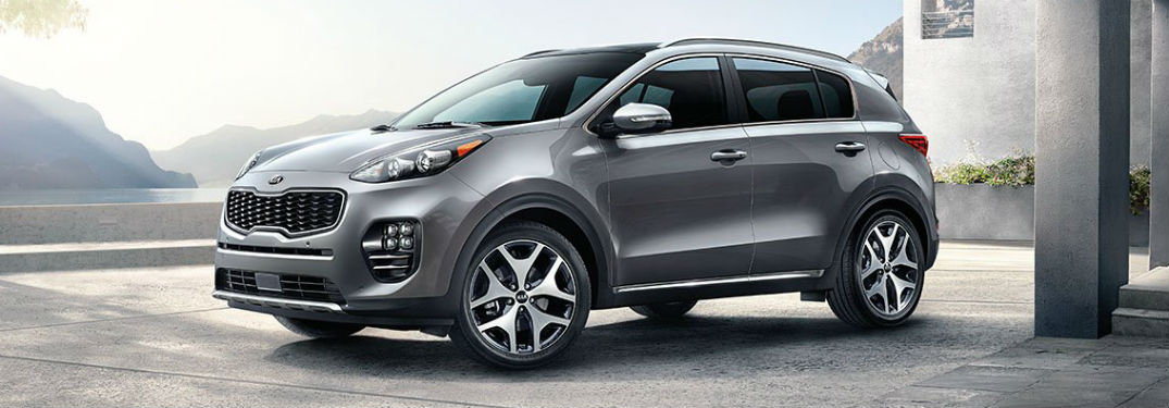 Driver side exterior view of a gray 2019 Kia Sportage