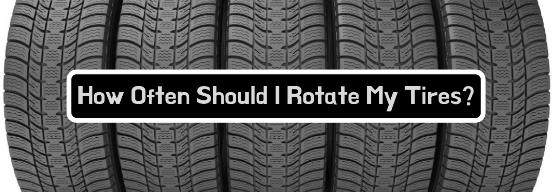 How Often Should I Rotate My Tires?, text on an image of new tires lined up tightly next to each other