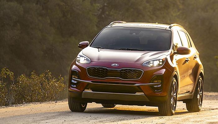 2020 Kia Sportage driving down a dirt road
