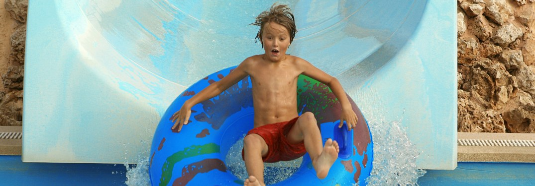 A child going down a waterpark slide