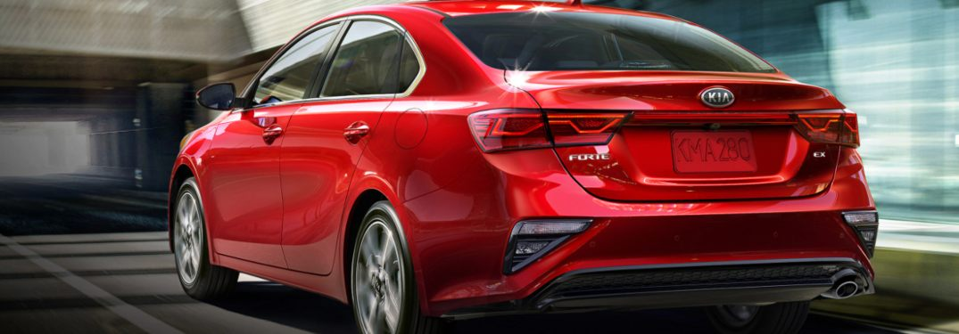 2021 Kia Forte Red driving through a tunnel in Dayton, OH