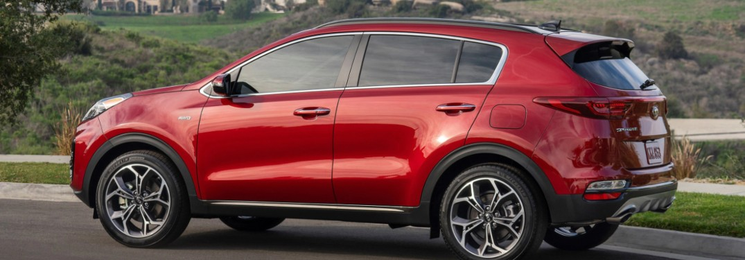 2022 Kia Sportage driving down a highway road