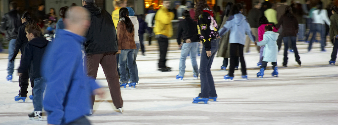 Group of People Skating on an Ice Rink
