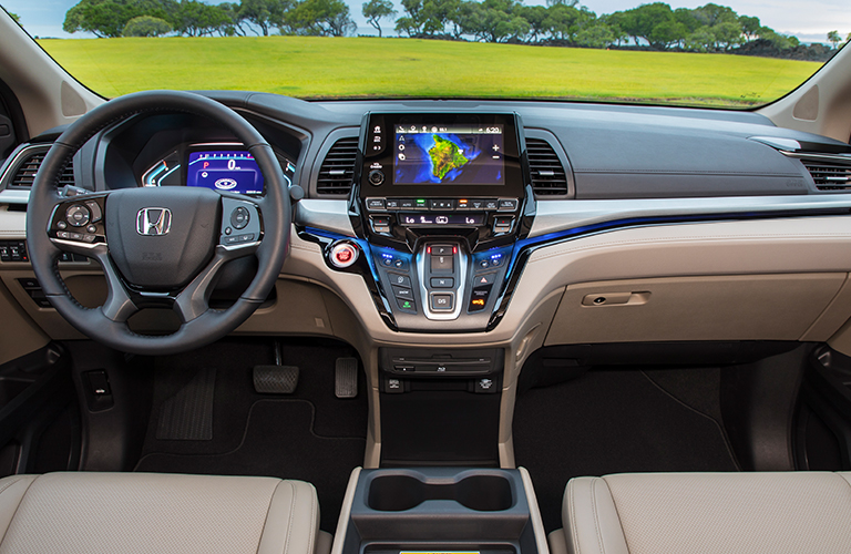 Interior view of the steering wheel and touchscreen of a 2019 Honda Odyssey