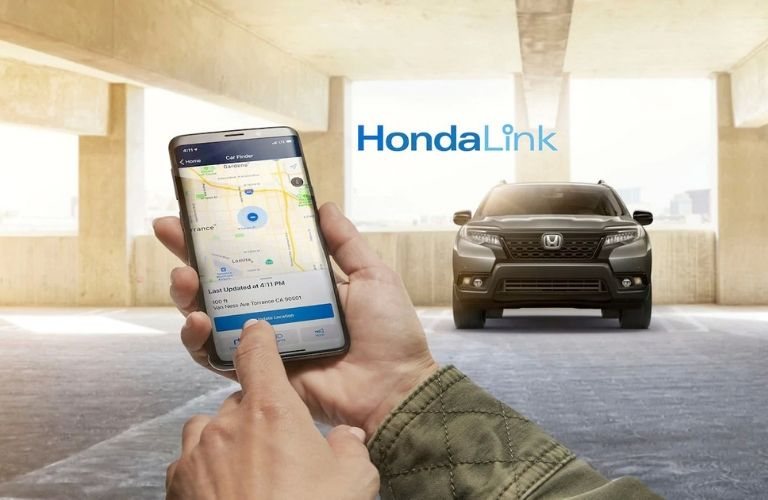 Image of a person using the HondaLink® mobile application