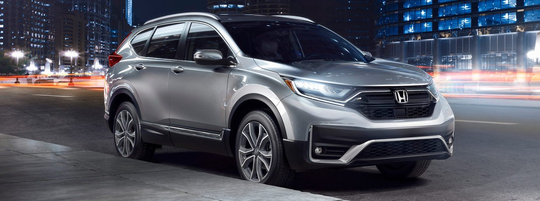 2020 Honda CR-V Touring exterior silver paint night with motion blurred car lights all around