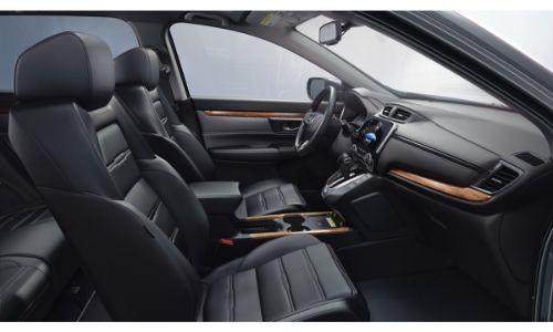 2020 Honda CR-V Touring interior shot through passenger door showing front leather seats