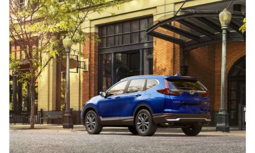 2020 Honda CR-V blue paint parked outside a building next to lamp posts