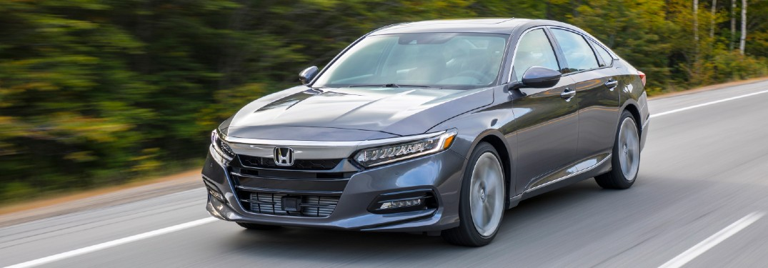 2020 Honda Accord Touring 2L black or grey driving down road with trees in background