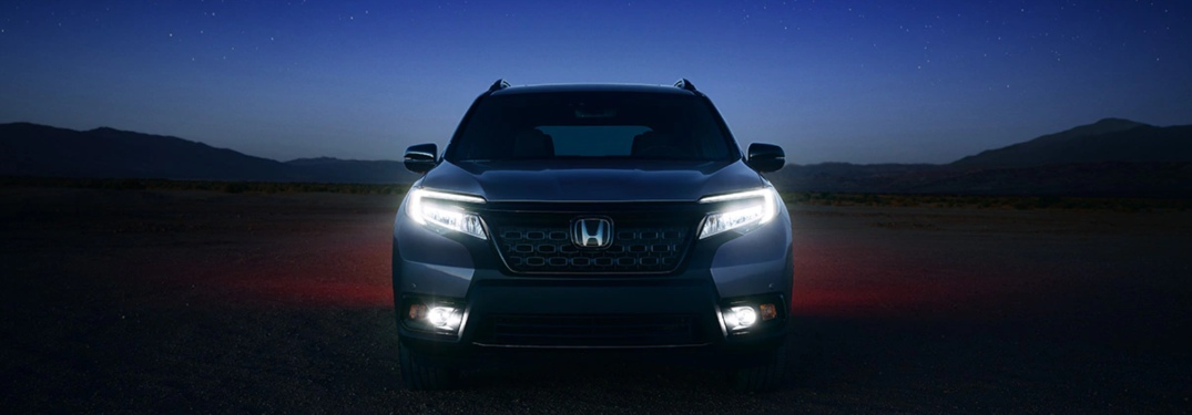 2020 Honda Passport parked on a dirt trail at night