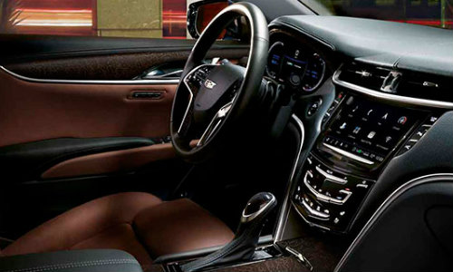 Front row of seating in 2018 Cadillac XTS with dashboard and steering wheel prominent