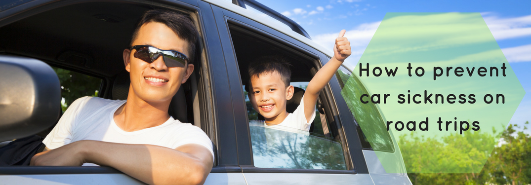man and child in car, how to prevent car sickness on road trips