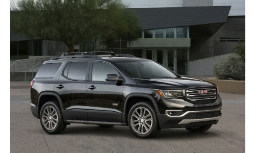 2018 GMC Acadia black outside family home with trees
