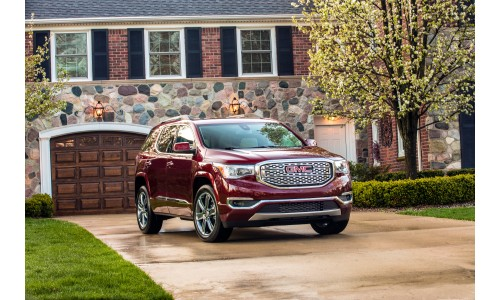 2018 GMC Acadia Denali exterior shot with red paint color parked outside a luxry house garage on the driveway
