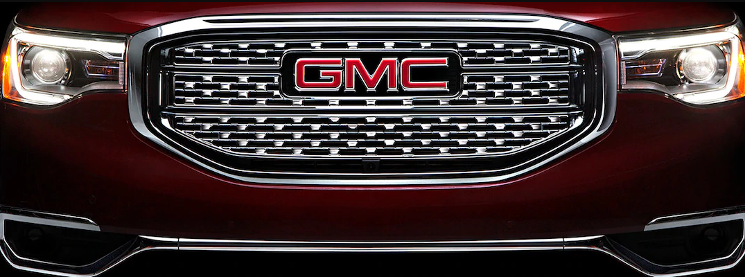 2018 GMC Denali exterior close up of masthead, grille, fascia, and nameplate badge
