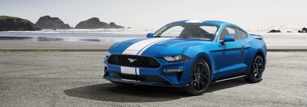 blue ford mustang on beach