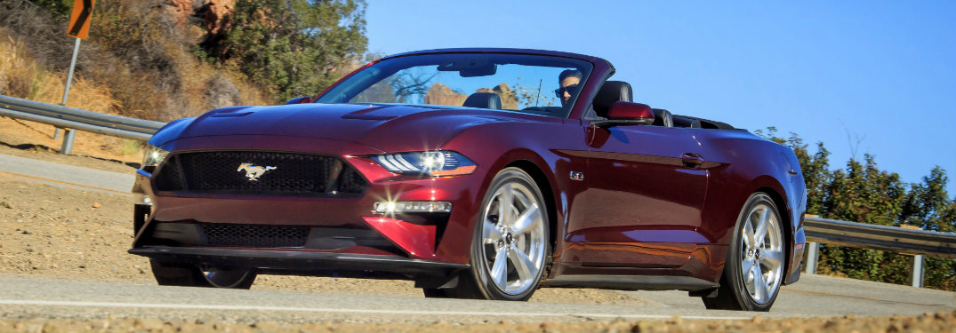 dark red ford mustang convertible
