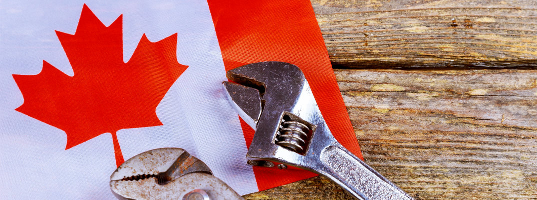 Wrench on top of Canadian flag to symbolize Labour Day