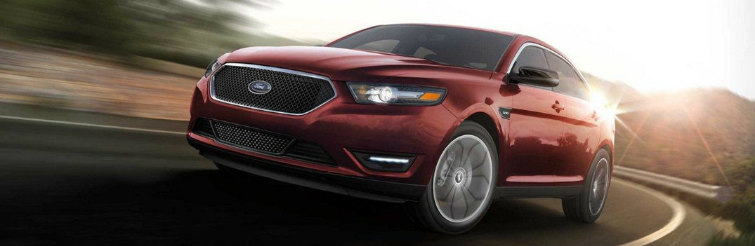 Red 2019 Ford Taurus speeding down road