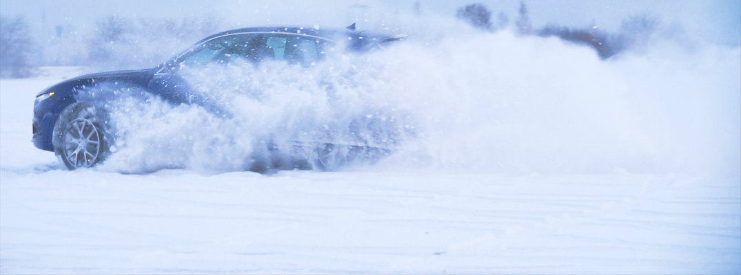 Car speeding and drifting through the snow