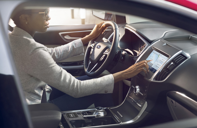 2020 Ford Edge front seating with driver behind steering wheel