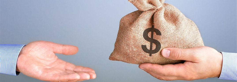 Hands exchanging money bag