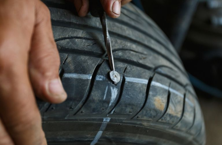 Tire having the nail removed