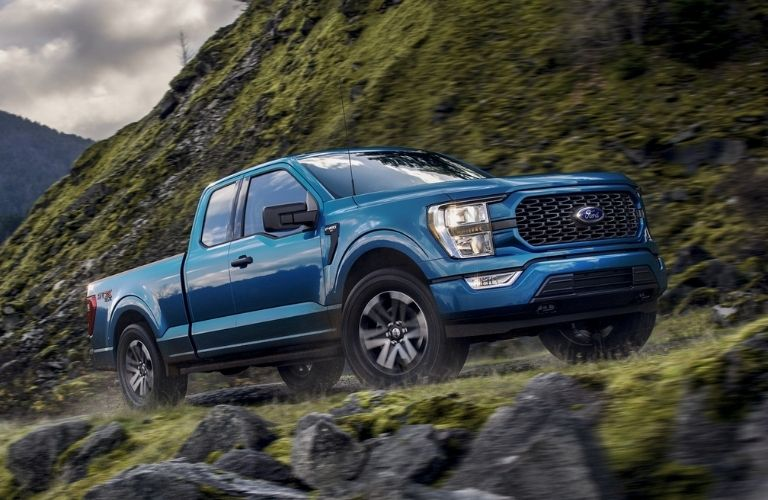 2021 Ford F-150 driving on a hill