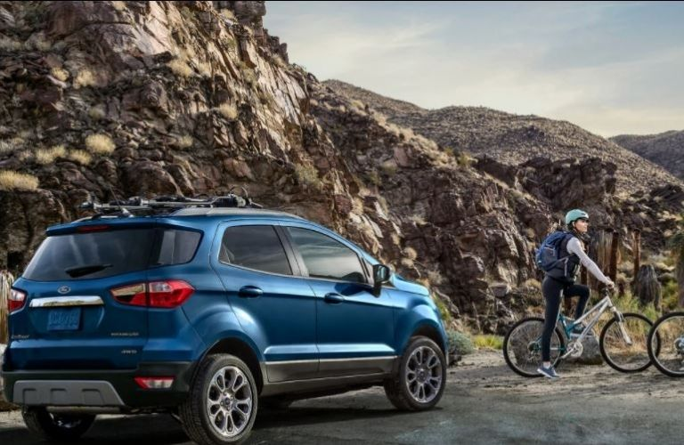 2020 Ford EcoSport parked near biker