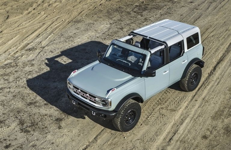 2021 Ford Bronco driving on sand and dirt