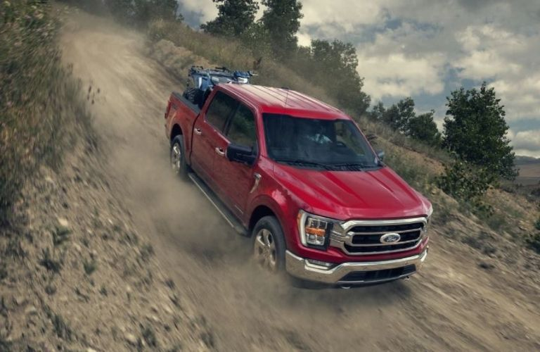 2021 Ford F-150 driving down a hill