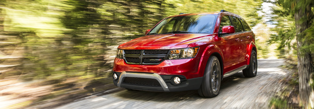 front and side view of red 2018 dodge journey