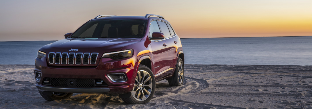 front and side view of red 2019 jeep cherokee