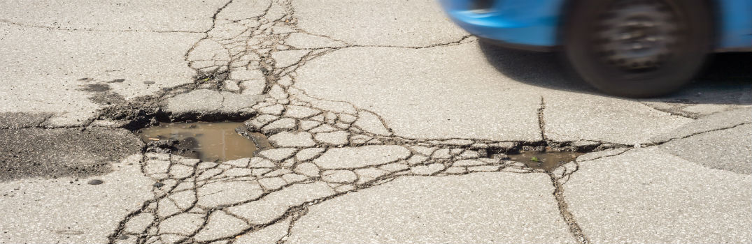 What causes potholes and how do I avoid them?