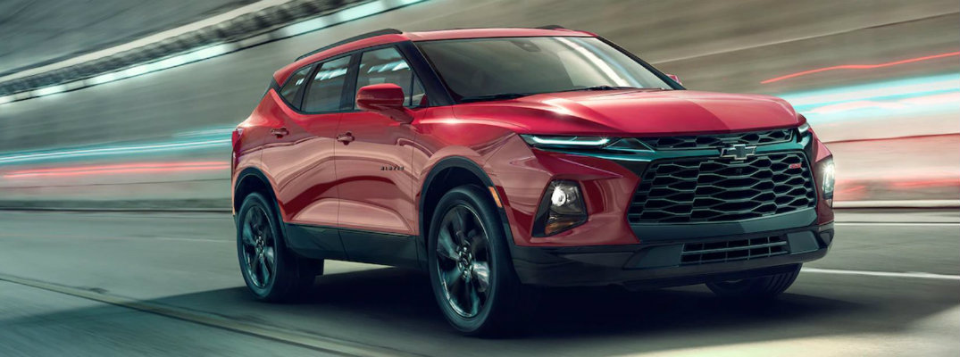 Exterior view of a red 2019 Chevrolet Blazer driving through a city tunnel