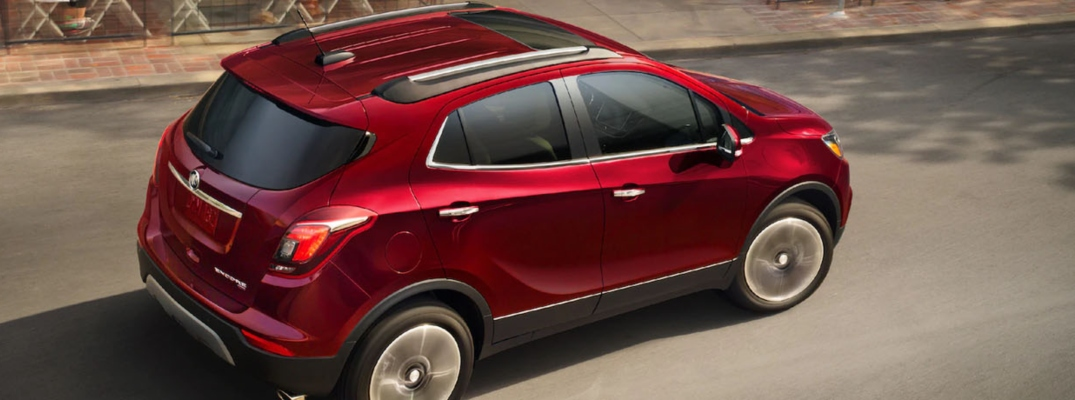 Exterior view of a red 2019 Buick Encore driving down a two-lane road