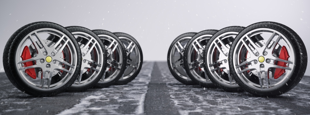 Image of 8 tires standing straight up on a gray service center floor