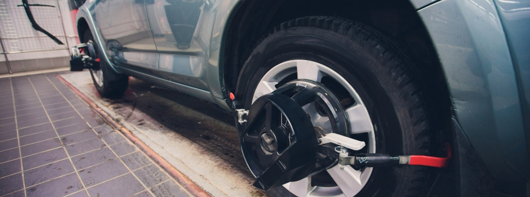 Image of wheel alignment service in process