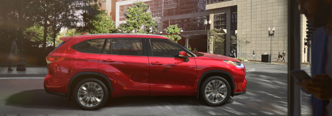 2020 Toyota Highlander exterior passenger side profile on street with trees